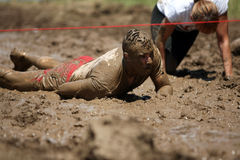 Mud running. People compete in a mud and obstacles run, in Bucharest, Romania Royalty Free Stock Image