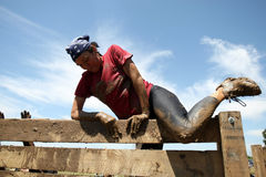Mud running. People compete in a mud and obstacles run, in Bucharest, Romania Royalty Free Stock Photos