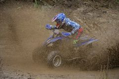 Through the mud. SERPUKHOV, RUSSIA - OCTOBER 7, 2017: Nikolaev Maksim 13,  Class ATV-JUNIORS, in the 4 stage  MX series, the Red Wings Cup 2017 super country Stock Images