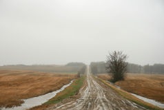 Mud and Sleet. A muddy road stretching into the sleet and fog Stock Photo