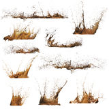 Mud splashes. A series of mud splashes on white background stock photo