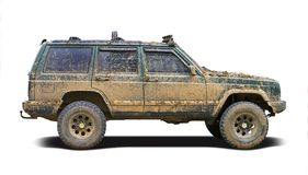 Mud splattered SUV. A green SUV splattered and caked with mud. Isolated on a white background Stock Photo