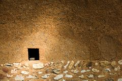 Mud and straw wall with small square window in the lower left and stones across the bottom. Beautiful mud and hay house in a rural village outisde if Beijing royalty free stock photos