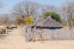 Mud straw and wooden hut with thatched roof in the bush. Local village in the rural Caprivi Strip, the most populated region in Na. Mibia, Africa royalty free stock photos