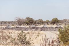 Mud straw and wooden hut with thatched roof in the bush. Local village in the rural Caprivi Strip, the most populated region in Na Royalty Free Stock Photo