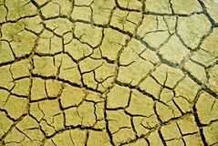 Mud Texture. Cracked mud in a pool on the salt marsh due to hot dry weather Stock Photo