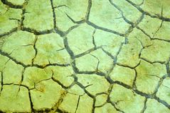 Mud Texture. Cracked mud under water in a pool on the salt marsh due to hot dry weather Stock Photo
