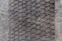 Mud texture or wet black soil as natural organic clay and geological sediment mixture as in roughing it in a dirty muddy country r. Oad bog after the rain or Royalty Free Stock Photo