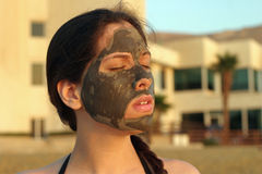 Mud treatment. At the Dead Sea royalty free stock photography