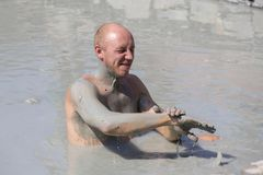 Mud treatment at the Dalyan, Turkey. Portrait happy man who takes a mud bath. Close up Stock Images