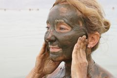 Mud treatment at the Dead Sea Royalty Free Stock Photography
