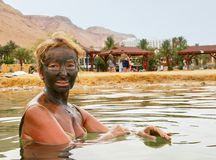 Mud treatment at the Dead Sea Royalty Free Stock Image