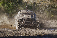 Mud Trials Off Road Action Racing. Vehicle racing through thick mud at high speed Royalty Free Stock Image