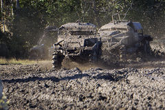 Mud Trials Off Road Action. Vehicles racing through thick mud at high speed Stock Images