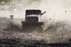 Mud Trials Off Road Racing Victory. Vehicle racing through thick mud at high speed Royalty Free Stock Photo