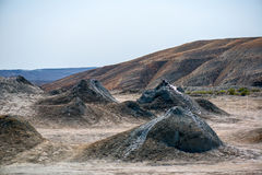 Mud Volcano. In Azerbaijan the mud volcano is created from mud, water, and gas forming slurries and building into domes. Here we have mud bubbling up and forming stock photos