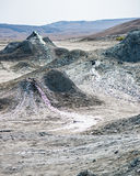 Mud Volcano. In Azerbaijan the mud volcano is created from mud, water, and gas forming slurries and building into domes. Here we have mud bubbling up and forming royalty free stock images