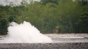 Mud volcano Bledug Kuwu, Indonesia. Mud volcano with bursting bubble bledug kuwu. volcanic plateau with geothermal activity and geysers, slow motion Indonesia stock footage