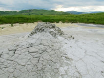 Mud volcano in Buzau, Romania. Mud volcanos in Buzau, Romania. Dried out grey dirt with cracks royalty free stock image