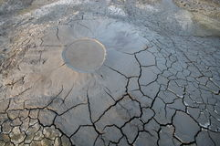 Bubbling mud. Mud volcano - landmark attraction in Buzau, Romania Stock Photos