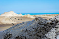 Mud volcano erupting mud, Gobustan, Azerbaijan Stock Photo