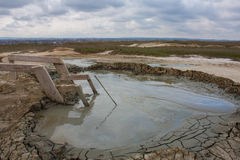 Mud volcano in the field Stock Photo