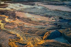 Mud volcano flowing Stock Photography