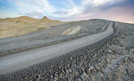 Mud volcano landscape at sunset. Bubbling mud - landmark attraction in Buzau, Romania Stock Photography