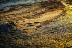 Mud volcano lava. Mud flowing from muddy volcano, Berca, Buzau, Romania stock photo