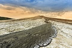 Mud volcano overflowing on bare mountain slope Royalty Free Stock Photography