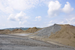 Mud volcanoes beneath summer sky Royalty Free Stock Photography