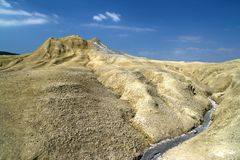 Mud volcano and dry crust. Mud volcanoes from Berca Romania are a spectacular feature  of volcano shapes structures , eruption of mud and natural gases stock image