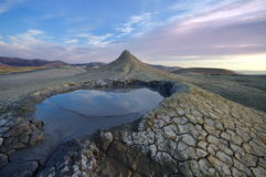 Bubbling mud. Mud volcano landscape at sunset - landmark attraction in Buzau, Romania Stock Photo
