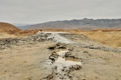 Mud volcanoes river Royalty Free Stock Photos