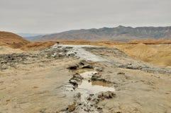 Mud volcanoes river Royalty Free Stock Photos