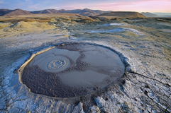 Bubbling mud. Mud volcano at sunset - landmark attraction in Buzau, Romania Stock Image