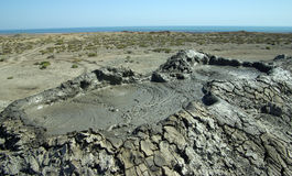 Mud vulcano and Caspian Sea Royalty Free Stock Photo