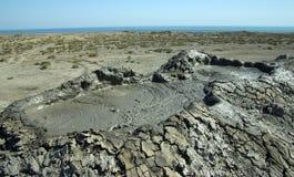 Mud vulcano and Caspian Sea Royalty Free Stock Photo