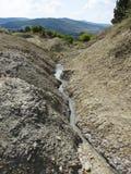 Mud vulcanoes Stock Images