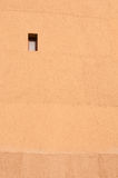 Mud wall. In sunny day ,a window on it Royalty Free Stock Photos