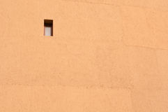 Mud wall. In sunny day ,a window on it Royalty Free Stock Photography