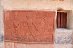 Tribal Culture. Mud wall painting significant of the tribal life in West Bengal-India Stock Photo