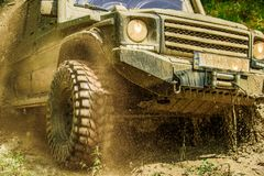 Mud and water splash in off-road racing. Drag racing car burns rubber. Extreme. Off-road car. Mud and water splash in off-road racing. Drag racing car burns royalty free stock images