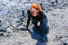 Mud wrap. The young girl covered with black mineral mud Royalty Free Stock Photo