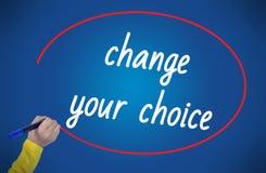 Mudança da escrita da mão da mulher sua escolha com marcador Foto de Stock Royalty Free