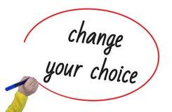 Mudança da escrita da mão da mulher sua escolha com marcador Imagens de Stock