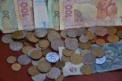 A mudança ucraniana das denominações e as moedas de circulação e a proibição Foto de Stock Royalty Free