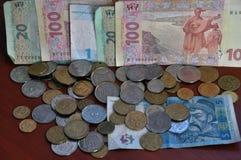 A mudança ucraniana das denominações e as moedas de circulação e a proibição Fotos de Stock Royalty Free