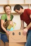 Mudanza feliz de la familia Imagen de archivo libre de regalías
