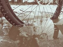 Mudd and water drops on bike tyre. Winter free ride in snowy landscape.  low temperature Royalty Free Stock Images